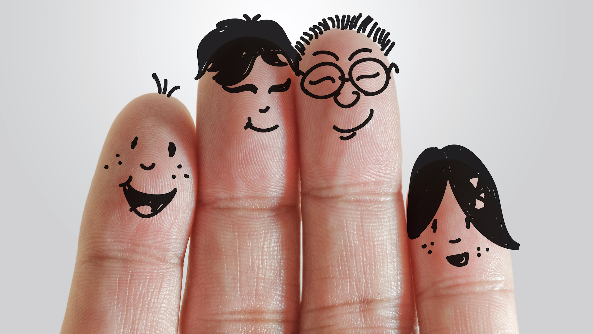 a set of fingers with people drawn on them