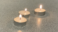 Three candles align on my table